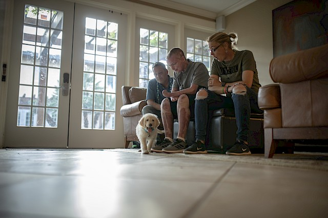 The Sutterfield family sits in the living area of a Fisher House. Zachary Sutterfield was severly injured in a fire. His parents, both veterans, have supported him during his recovery and rehabilitation.