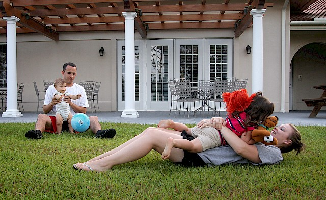 Christine Garcia plays with her daughter, Mikaelah, as her husband, John, and son Jordan play together in the back yard of the Fisher House on Tuesday, May 24, 2011.